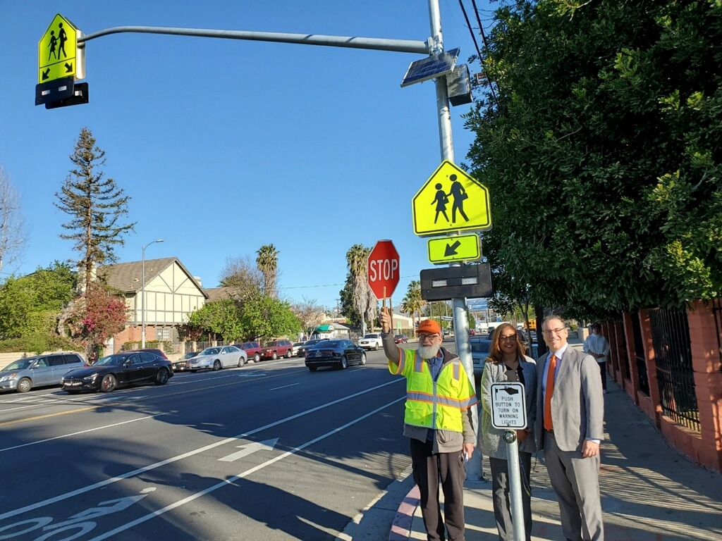 Flashing pedestrian crosswalk on Winnetka Ave. at Lanark St